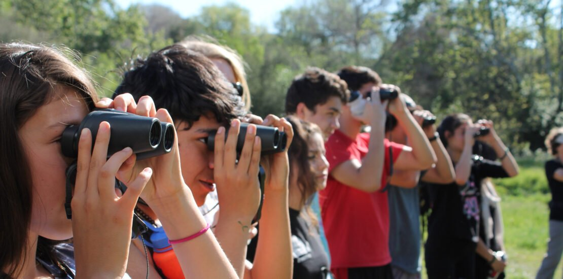 Kids with binoculars, from Outdoor Outreach